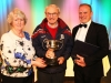 Eileen Connolly presents the Best Director (Open) Cup to Mike Hession Compántas Lir for their Production of The Glass Menagerie in the 48th Claremorris Drama and Fringe festival. With the adjudicator Ciarán McCauley. Photo © Michael Donnelly